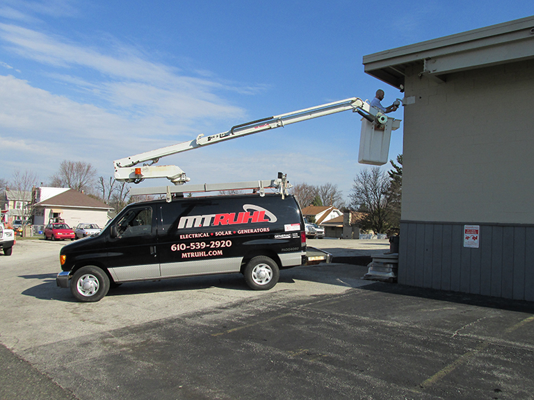 electrician installing surveillance camera on a bucket truck